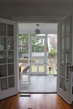 Like our back porch but with French doors .
