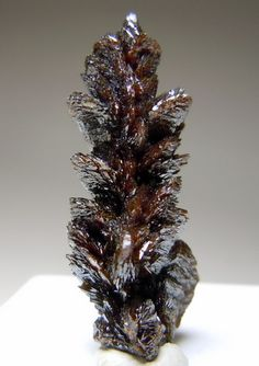 Descloizite- a rare mineral species consisting of basic lead and zinc vanadate. The color is deep cherry-red to brown or black, and the crystals are transparent or translucent with a greasy lustre; the streak is orange-yellow to brown. A variety known as cuprodescloizite is dull green in color; it contains a considerable amount of copper replacing zinc and some arsenic replacing vanadium.