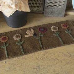 primitive wool penny rug with bee . . .