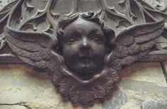 18th century carving of a cherub's head in Ledbury Church.