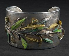 EUCALYPTUS bracelet with emeralds and enamels by Laomi Scanavini Gioielli