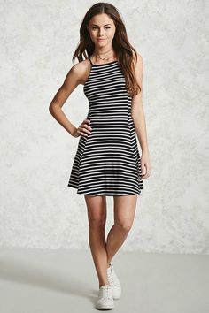 A ribbed knit mini dress featuring a stripe print, a square neckline, cami straps, and a slightly flared skirt.
