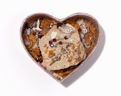Kurt and Courtney collected many heart-shaped boxes. They would give them to each other as gifts, sometimes filled with a piece of their hair or a love note. The stone in this particular box is piece of the Roman Colosseum that Kurt broke off on his final trip to Italy. Photo by Geoff Moore