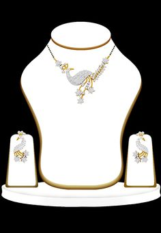 #White #Stone #Studded #Mangalsutra with #Earrings for #Indian #Brides.  See them here : http://www.utsavfashion.com/jewelry/mangalsutra-type