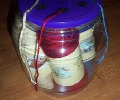 I hated to throw out such a perfectly good cheese ball container, and this is what I came up with. You could use any container and decide how many skeins ...