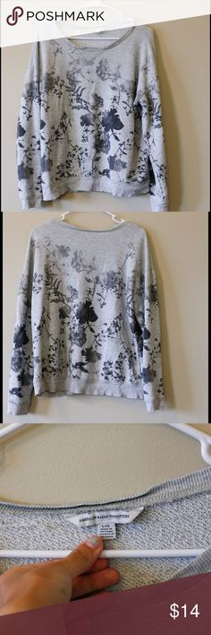 AE sweater -Grey floral American eagle sweater -slightly cropped -80% cotton 20% polyester. Some minor pilling but in good shape American Eagle Outfitters Sweaters Crew & Scoop Necks