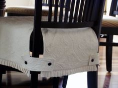 I like the tab idea for slipcovers rather than the usual tied strings, much cleaner. Simple sewing project idea.