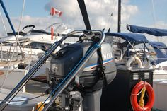 Outboard motor hoist and outboard motor harness for sailing yachts. Outboard Motors, Sailing, Candle