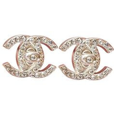 Pre-owned Authentic Chanel Rare Silver Rhinestone Gold Turnlock CC Earrings ($399) found on Polyvore