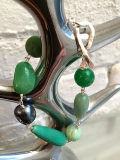 Bracelet in fine silver with different shades of green semi precious stones.