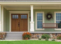 CLOSE, but find raised 3panel door with same dentil shelf and 3 windows in mahogany. (not wood) Pella Architect Series Entry Doors | Fiberglass Doors | Pella.com