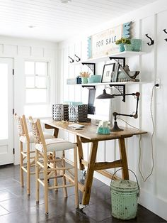 A secondhand pine table and comfy barstools turned this mudroom into an accessible office.