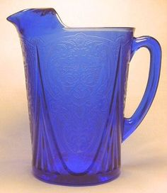 """Blue Royal Lace Straight Sided Pitcher with Ice lip (yeah they had one without an ice lip and one with """"non-straight"""" sides too). This was made by Hazel Atlas in the mid-40's"""