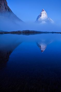 The Matterhorn, reflecting in the Riffelsee lake, Valais, Switzerland