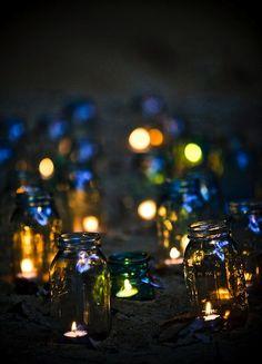 Mason jar candles light up the beach like stars in the sky! 