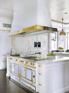 La Cornue range with custom hood and gold accents | Mitchell Wall Architecture & Design