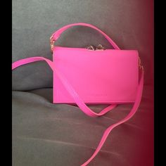 Ted Baker HOT pink small clutch NWT Ted Baker small patent leather clutch handbag. Fits an iPhone 6 with a case and a few credit cards. Pretty slim but perfect for a day out and about! Ted Baker Bags Clutches & Wristlets