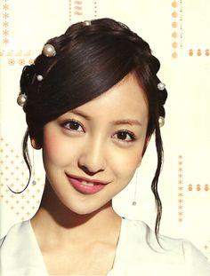Tomomi Itano (Japanese idol, AKB48). Emobile catalogue 2013.   Pearl pin hairstyle.