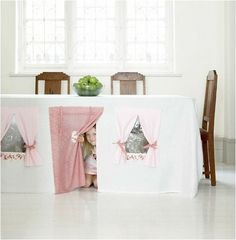 tablecloth tent works well on a table with four legs like this large dining room table, but a smaller version could be make for a card table. Card table is not a new idea, but colors that match the decor are a great idea.