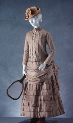 """Tennis Dress: ca. 1880-1890, English, tussore silk. """"Tennis only started to be played by women as late as the 1870s, after Major Wingfield patented the modern tennis court in 1873... This particular style of tennis dress with an ankle length skirt was popular until 1910 when garments became lighter and less restrictive..."""""""
