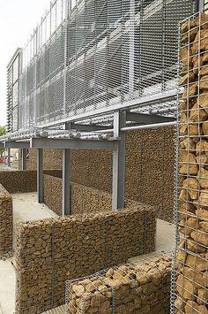 narrow gabion walls around piers Facade Design, Door Design, Exterior Design, Natural Stone Wall, Gabion Wall, Stone Facade, Modern Architects, Exterior Siding, Building Materials