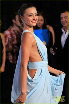 Miranda Kerr strikes a pose in Carla Zampatti at the 2012 Women of Style Awards... (men on the red carpet need to be meet the standard of coming half dressed)
