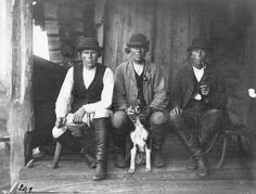 The Finnish huntingbrothers Petri, Iivana and Jyrki Vornanen. 1893. Photo: I. K. Inha (The dog in the picture: Karelian bearhunting dog)
