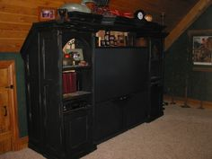 Entertainment center for Lodge.  Difficult roof line to match.  This was a 4 day project.
