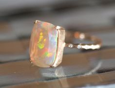 Simple gold and opal ring