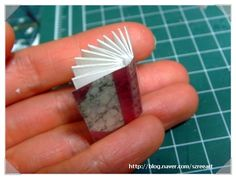 create this simple book : tutorial at link. «» so tiny! i giggle at its tininess.