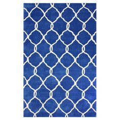 Anchor your living room seating group or define space in the den with this artfully hand-tufted rug, featuring an interlocking trellis motif for eye-catching...