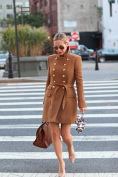 Love this camel coat with the red lips.