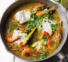 Coconut fish curry: This colourful hake and prawn one-pot has Thai and Indian inspired flavours and is quick enough for midweek - ready in under 30 minutes Bbc Good Food Recipes, Indian Food Recipes, Asian Recipes, Cooking Recipes, Healthy Recipes, Thai Recipes, Basa Fish Recipes, Indonesian Recipes, Healthy Breakfasts
