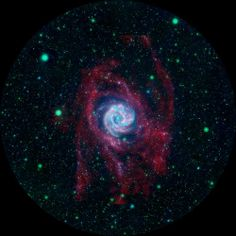 The outlying regions around the Southern Pinwheel galaxy, or M83, are highlighted in this composite image from NASA's Galaxy Evolution Explorer and the National Science Foundation's Very Large Array in New Mexico. The blue and pink pinwheel in the center is the galaxy's main stellar disk, while the flapping, ribbon-like structures are its extended arms. - Credit: NASA/JPL