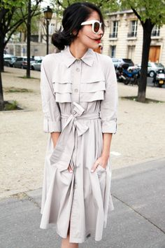 Cutest trench dress.  Also love the white shades.