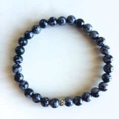 Genuine Snowflake Obsidian Bracelet w/ Sterling Silver Charm   ~ 6mm Beads by peaceofmindinc. Explore more products on http://peaceofmindinc.etsy.com