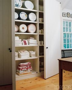 floor to ceiling storage for occasional linens and tableware