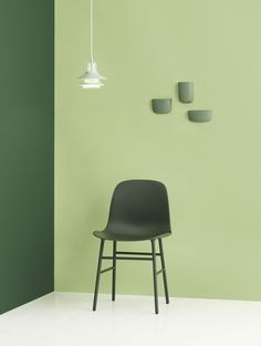 Green hues   Form Chair with steel legs   Ikono Lamp   Wall-mounted pockets