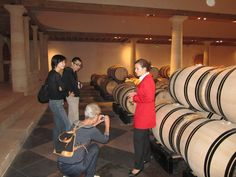 A very enthusiastic guide showing us the secrets to great wine in Chateau Haut Brion.