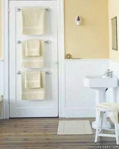 Save space by installing towel rods behind the door