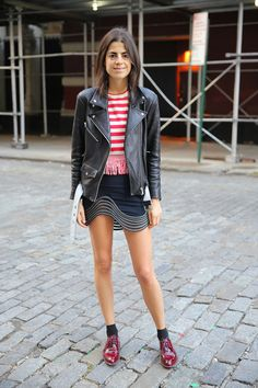 @manrepeller wearing a cute striped red tee + moto jacket + mini skirt