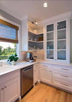 Kitchen Cabinet. The cabinet in this kitchen is open and reminds you of open shelves. Changing this look is easy. You just need to install the cabinet doors back. #Kitchen #Cabinet #KitchenCabinet