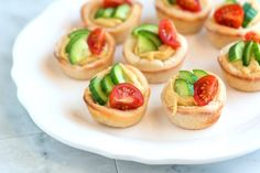 These cute easy appetizer cups filled with hummus, cucumber and a little tomato are perfect for easy entertaining. They'll be gone in minutes.