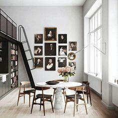 Dining Furniture Ideas : Double height wall with art frames -Read More –