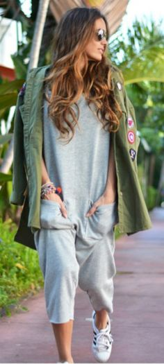 María + comfortable yet collected + grey jumpsuit + cool dimension + patched jacket and sneakers + look more alternative.   Brands not specified