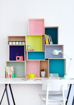 Repurpose boxes and crates for modular bookshelves and eye-popping storage displays.