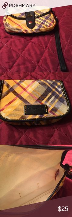 Dooney and Bourke Plaid Wristlet Colors yellow purple and red plaid in good condition. Little wear on the inside but not noticeable. Dooney & Bourke Bags Clutches & Wristlets