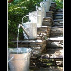 What a great way to have water for the grandkids to play in out in the garden!