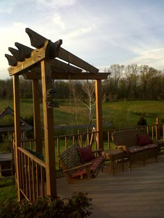 This is our corner pergola we built to make a solid and permanent patio swing out out of. We had lots of trouble with porch wings blowing off the patio so we made a permanent fix! :)