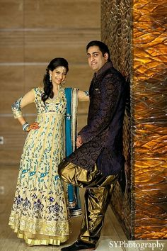 An Indian bride and groom pose for pictures during their wedding celebrations in Las Vegas.